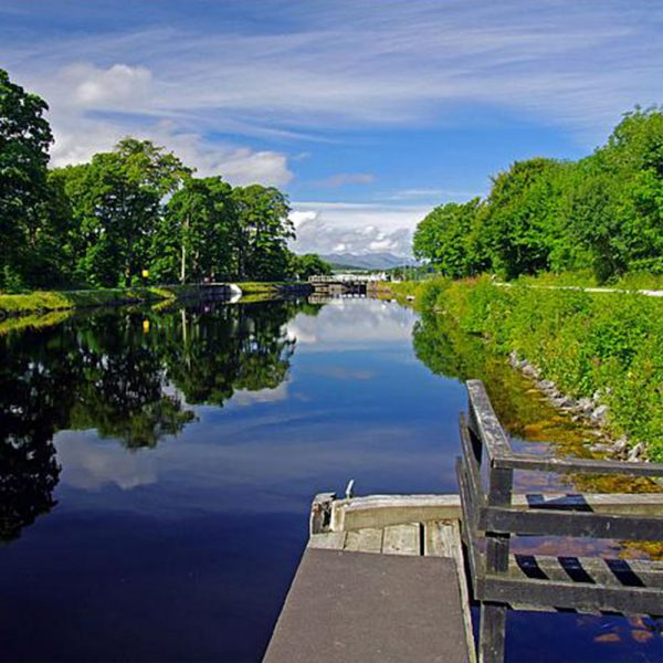 The Caledonian Canal with still waters on a summers day