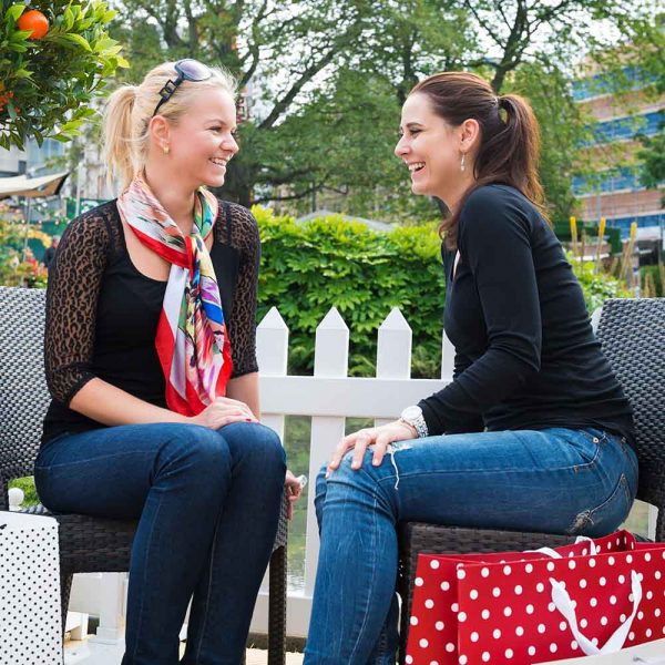 two women having a chat outside after shopping